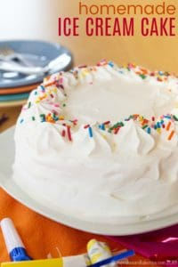Homemade Ice Cream Cake Covered in Whipped Cream and Sprinkles