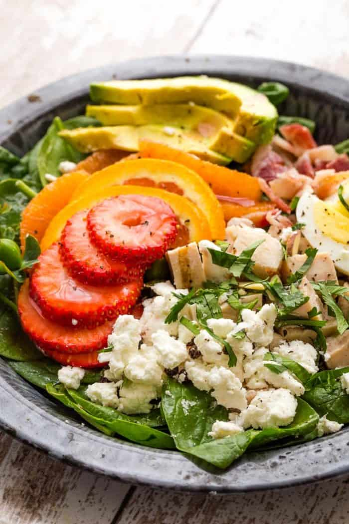 Closeup of Cobb-Style Strawberry Avocado Spinach Salad with Poppyseed Dressing