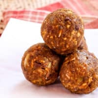 A small stack of easy pumpkin energy balls on a napkin