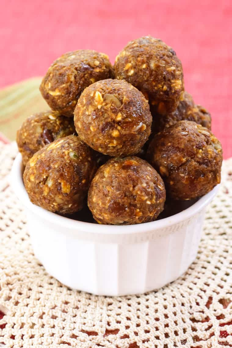 No-Bake Pumpkin Spice Energy Balls stacked in a white bowl