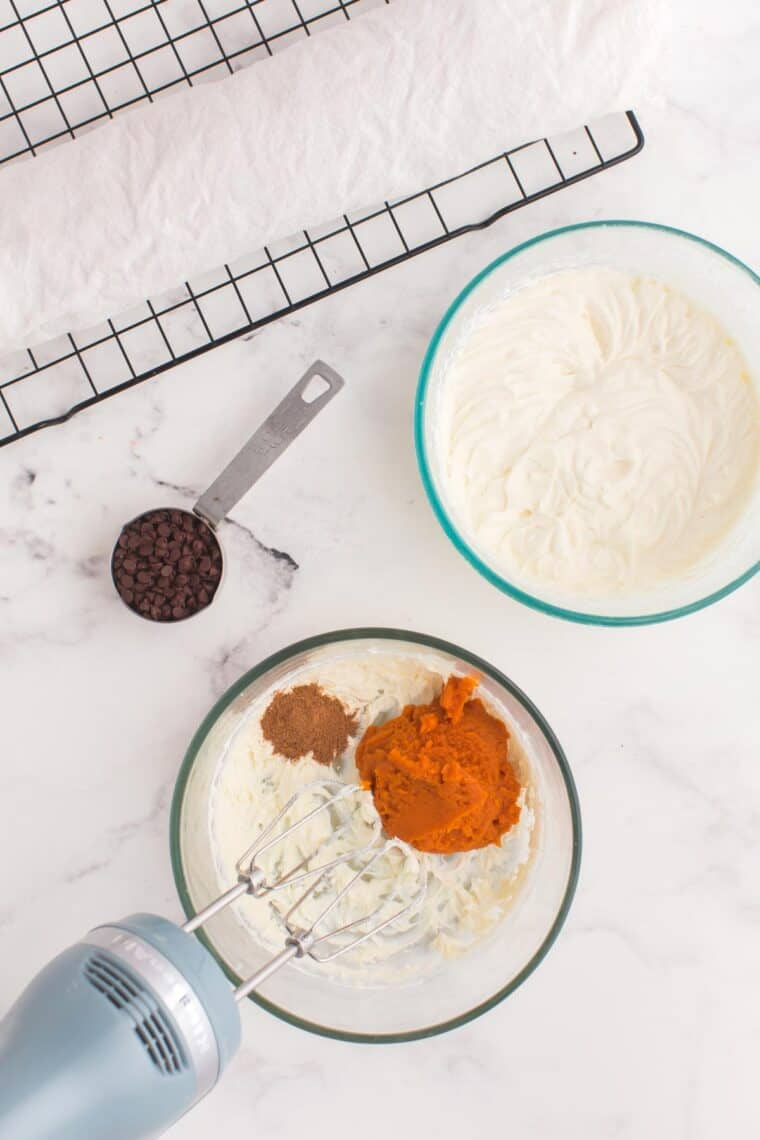 Combining pumpkin pie spice, pumpkin, whipped cream and whipped cream cheese