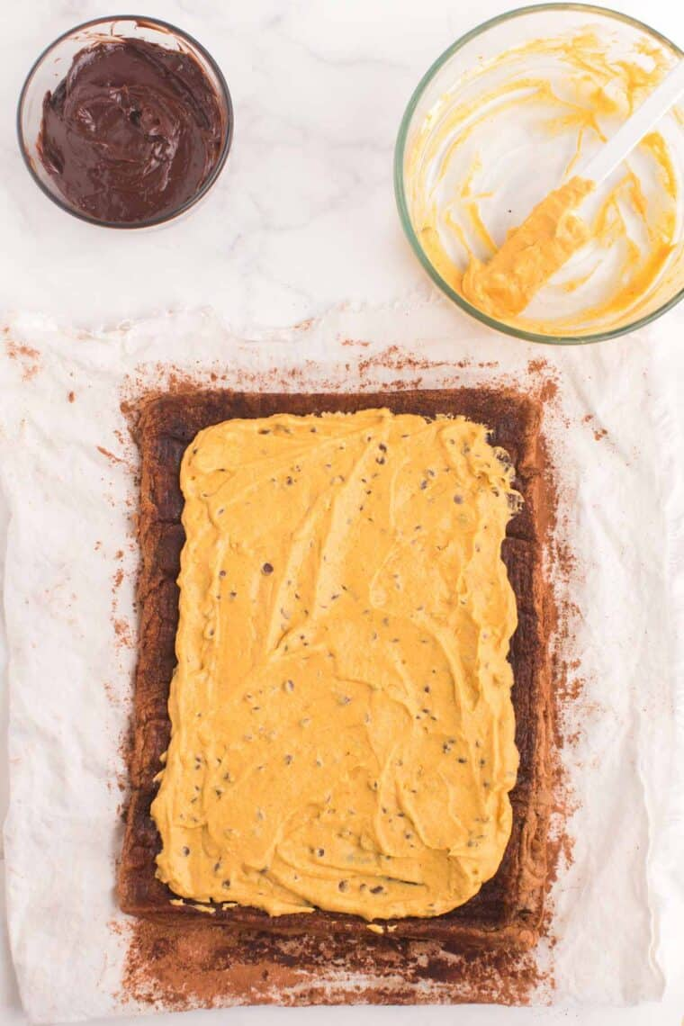 Chocolate cake rolled out and covered with pumpkin mousse