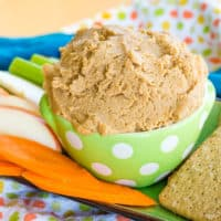 Peanut Butter Cookie Dough Dip in a green bowl on a platter with snacks