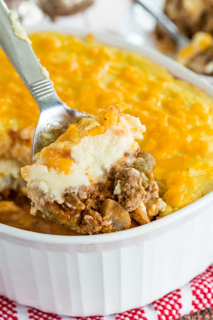 A spoonful of low carb Shepherd's Pie with Cauliflower Mash and cheddar cheese