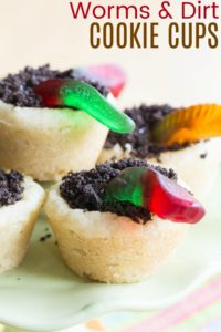 Sugar Cookie Cup Recipe filled with chocolate ganache, gummy worms, and Oreo crumbs for dirt