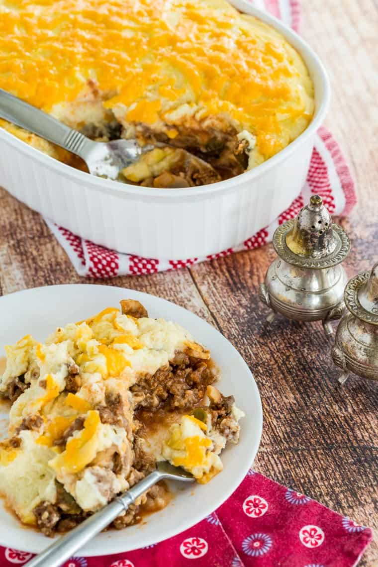 Cheesy Cauliflower Shepherd's Pie scooped from a casserole dish onto a plate