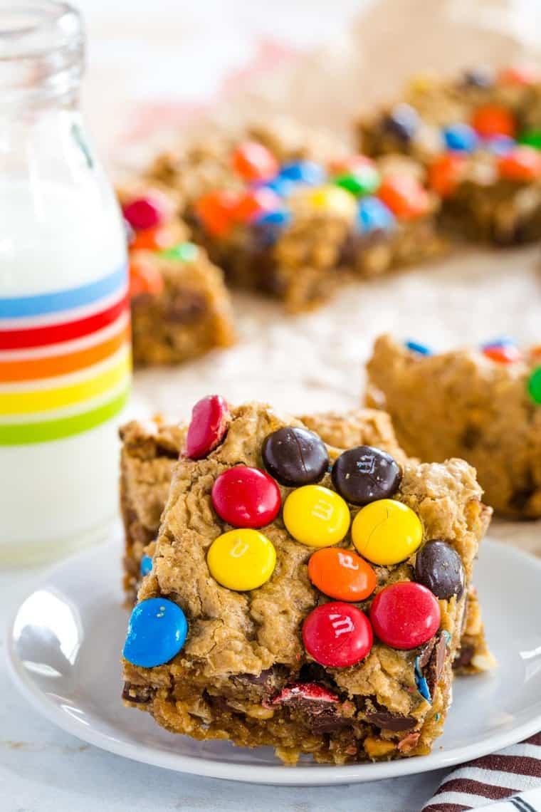 Best Monster Cookie Bars topped with M&Ms on a plate