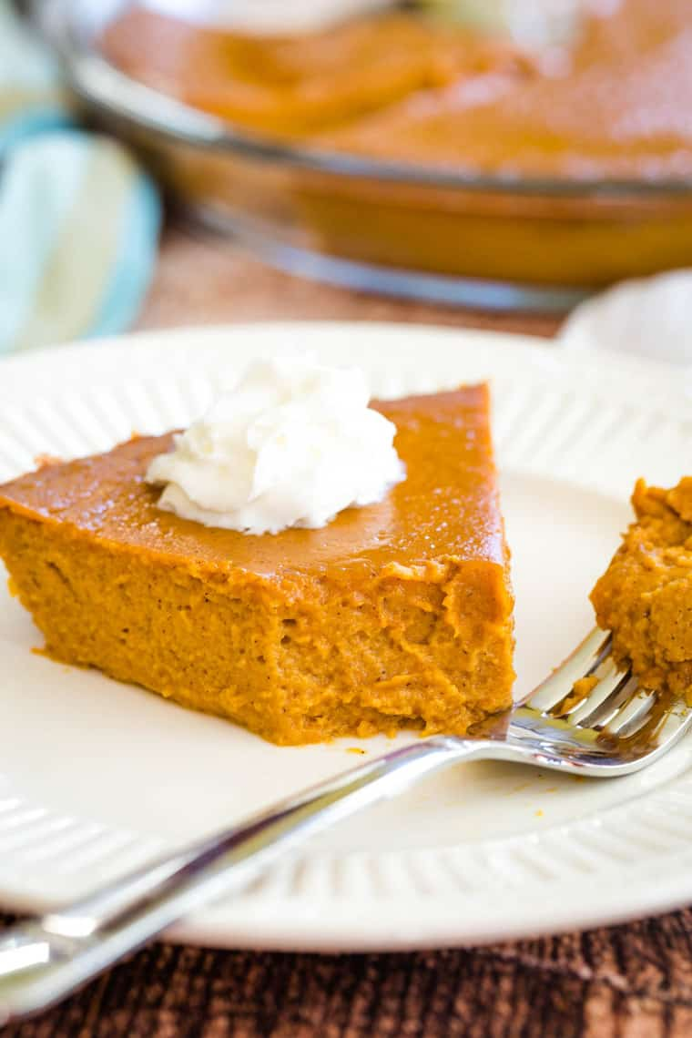 Crustless Pumpkin Pie with a bite taken from a slice