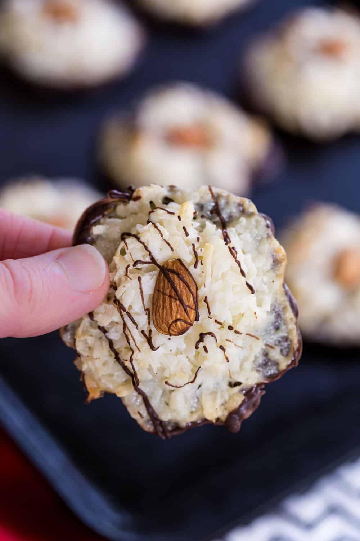 Fingers holding an Almond Joy Macaroon Cookie