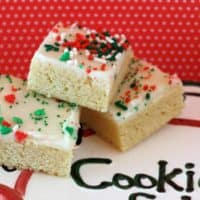 Frosted Sugar Cookie bars with Christmas Sprinkles on a cookie plate