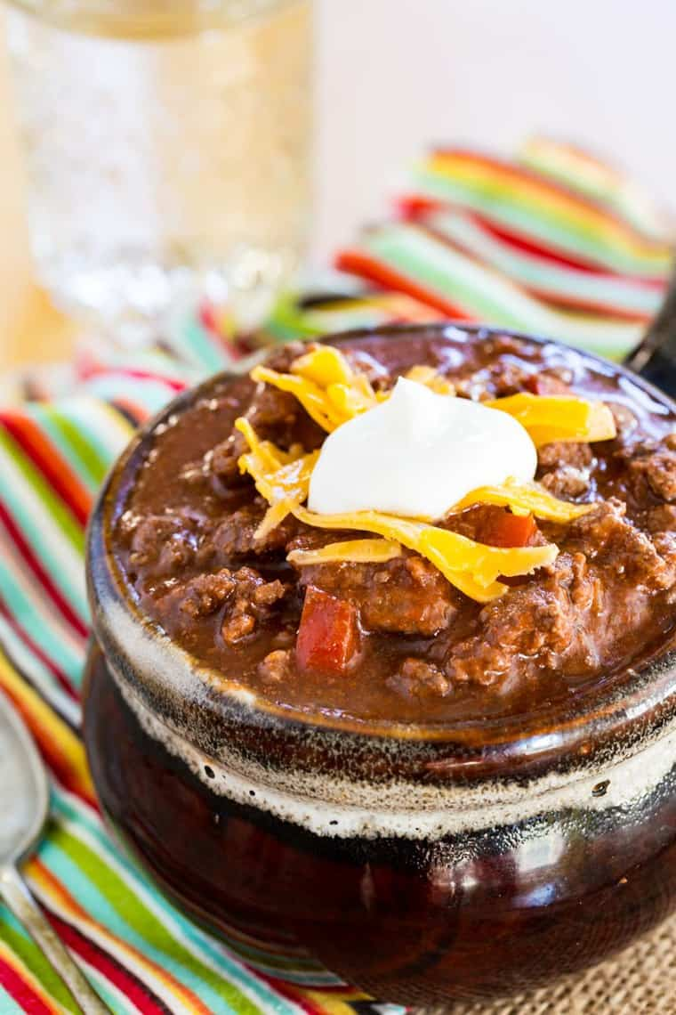 Keto Chili without Beans topped with cheese and sour cream