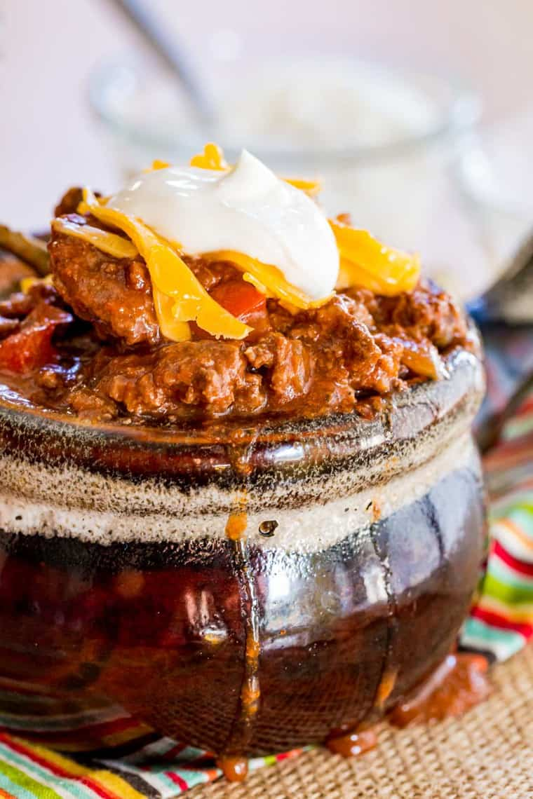 Closeup of Keto Chili in a bowl dripping over the edges
