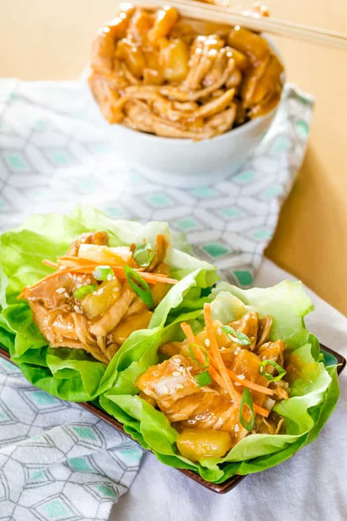 Two Teriyaki Chicken Lettuce Wraps on a rectangular plate