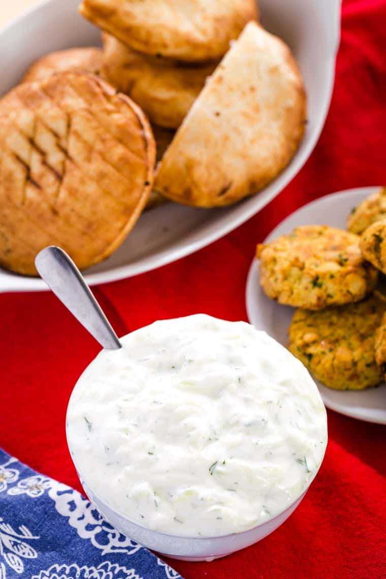 Bowl of Tzatziki sauce with pita and falafel