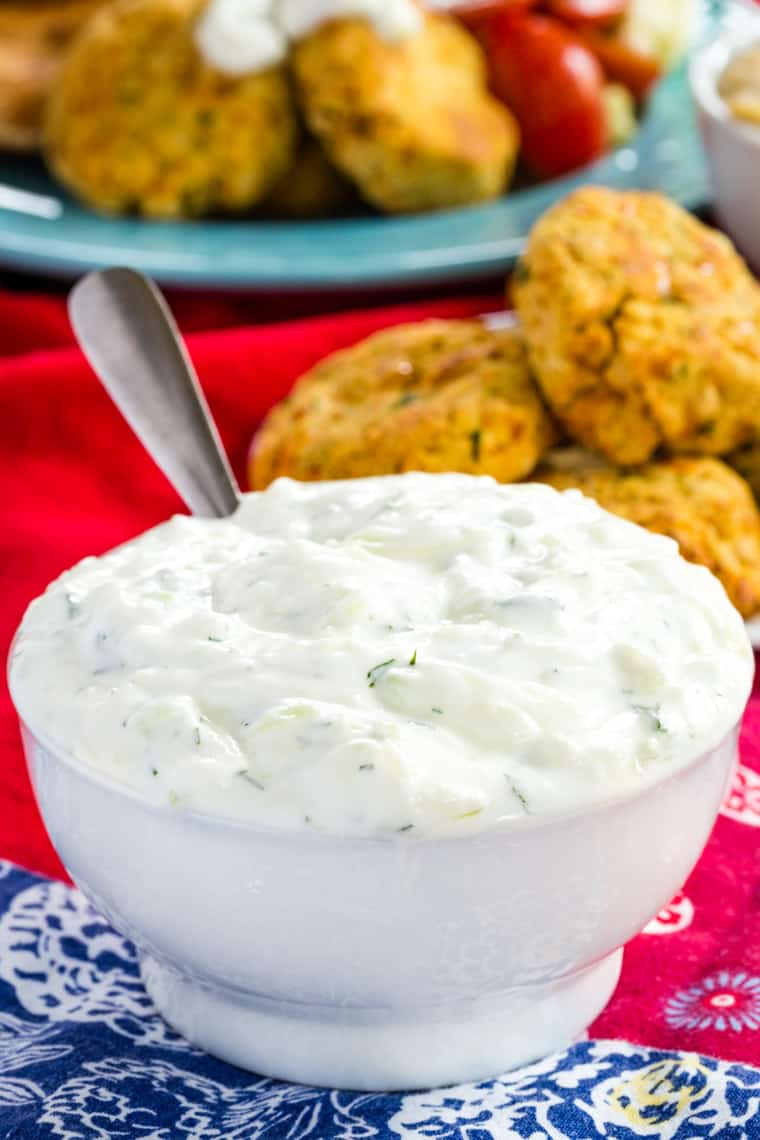 Easy Tzatziki Sauce in a White bowl with falafel in background