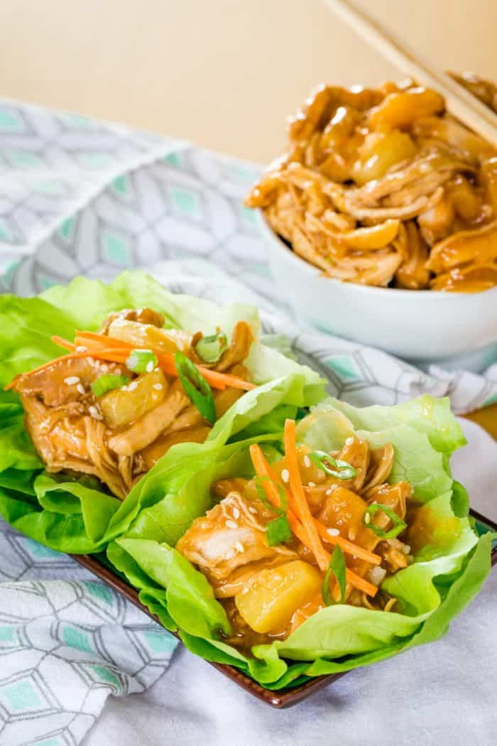 Chicken Teriyaki Lettuce Wraps with a bowl of shredded teriyaki chicken