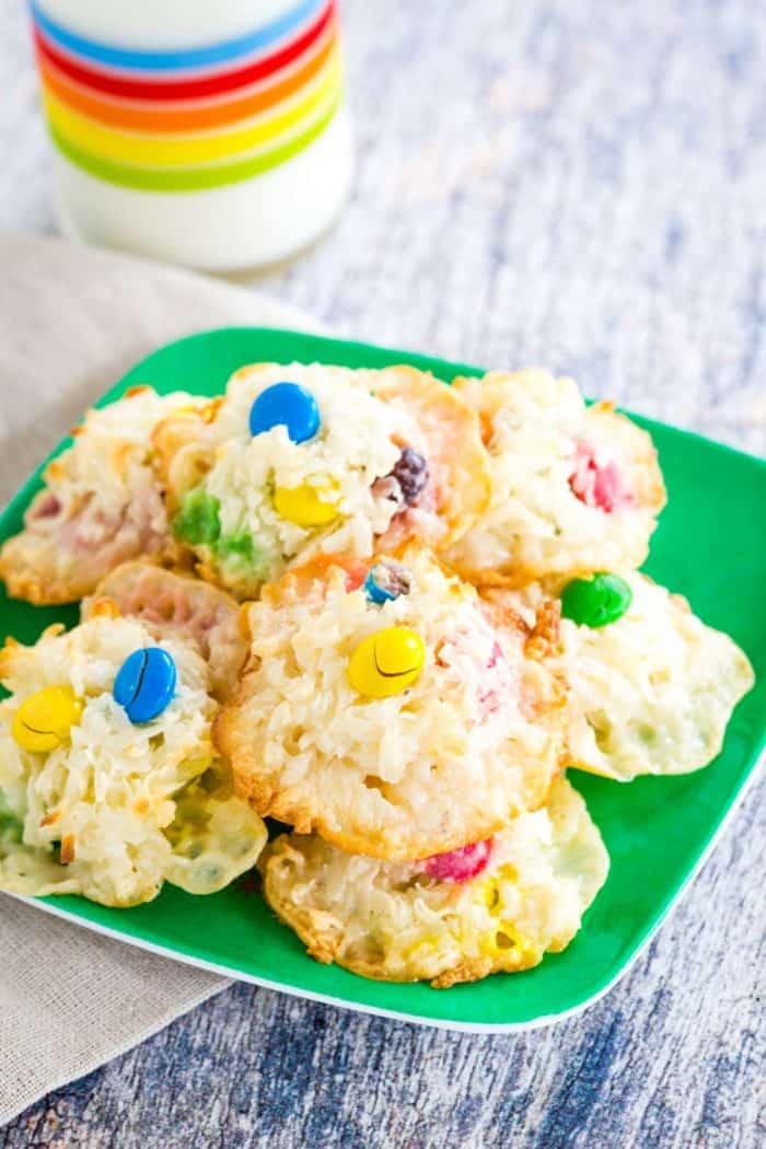 Green plate with a pile of Coconut Macaroons with M&M's