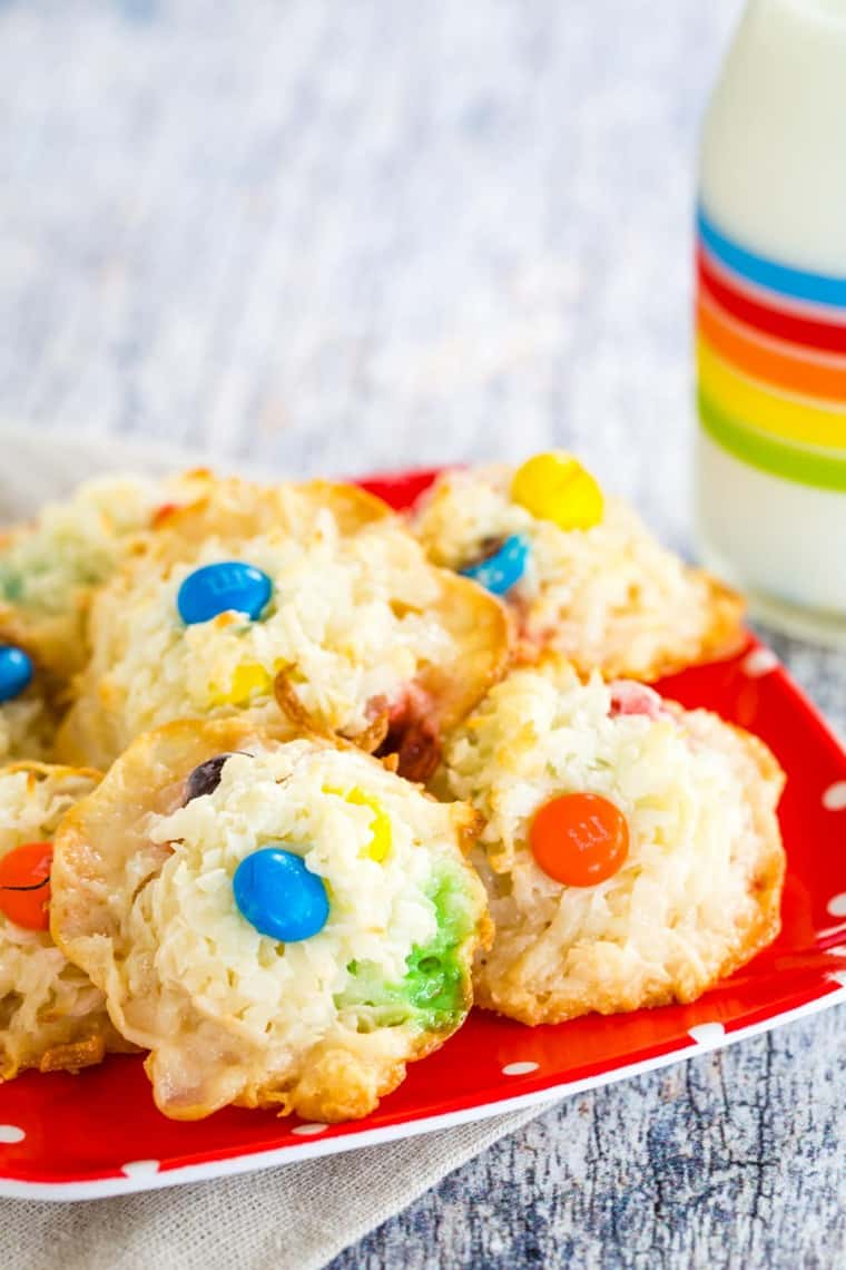 Coconut Macaroons with M&M's chocolate candies on a red plate