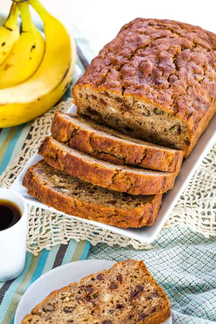 A slice loaf of gluten free banana nut bread