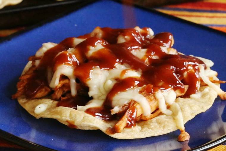 Top BBQ Chicken Tostadas with more barbecue sauce