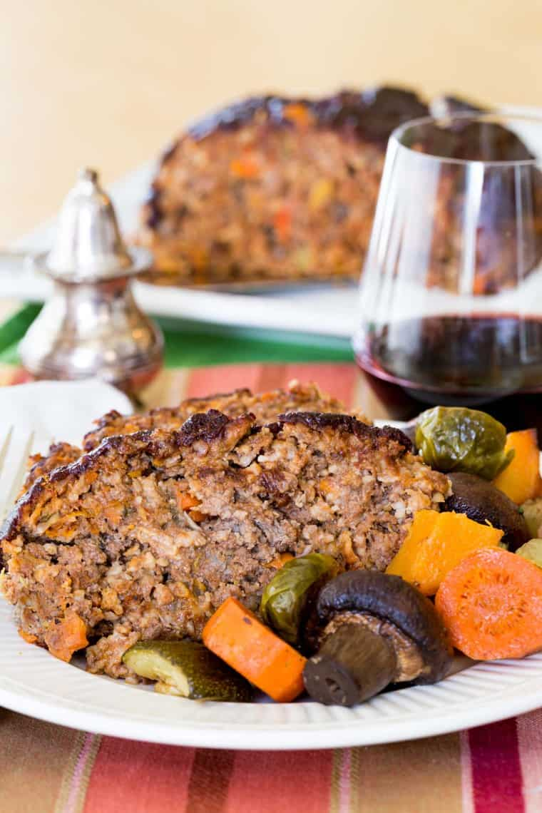 Slices of Balsamic Meatloaf on a plate with roasted vegetables