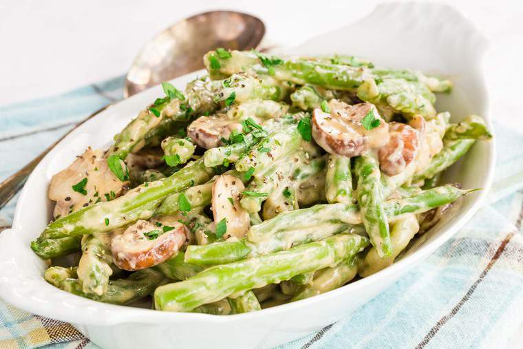Creamy Green Beans with Mushrooms sprinkled with parsley and pepper