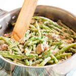 Creamy Skillet Green Beans and Mushrooms in a pan with tongs