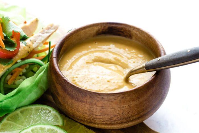 Easy Thai Peanut Sauce in a bowl next to lettuce wraps