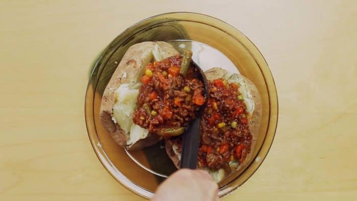 Fill baked potatoes with ground beef and vegetables mixture