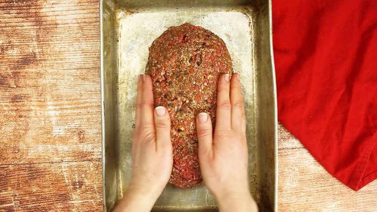 Pressing meatloaf together in baking pan