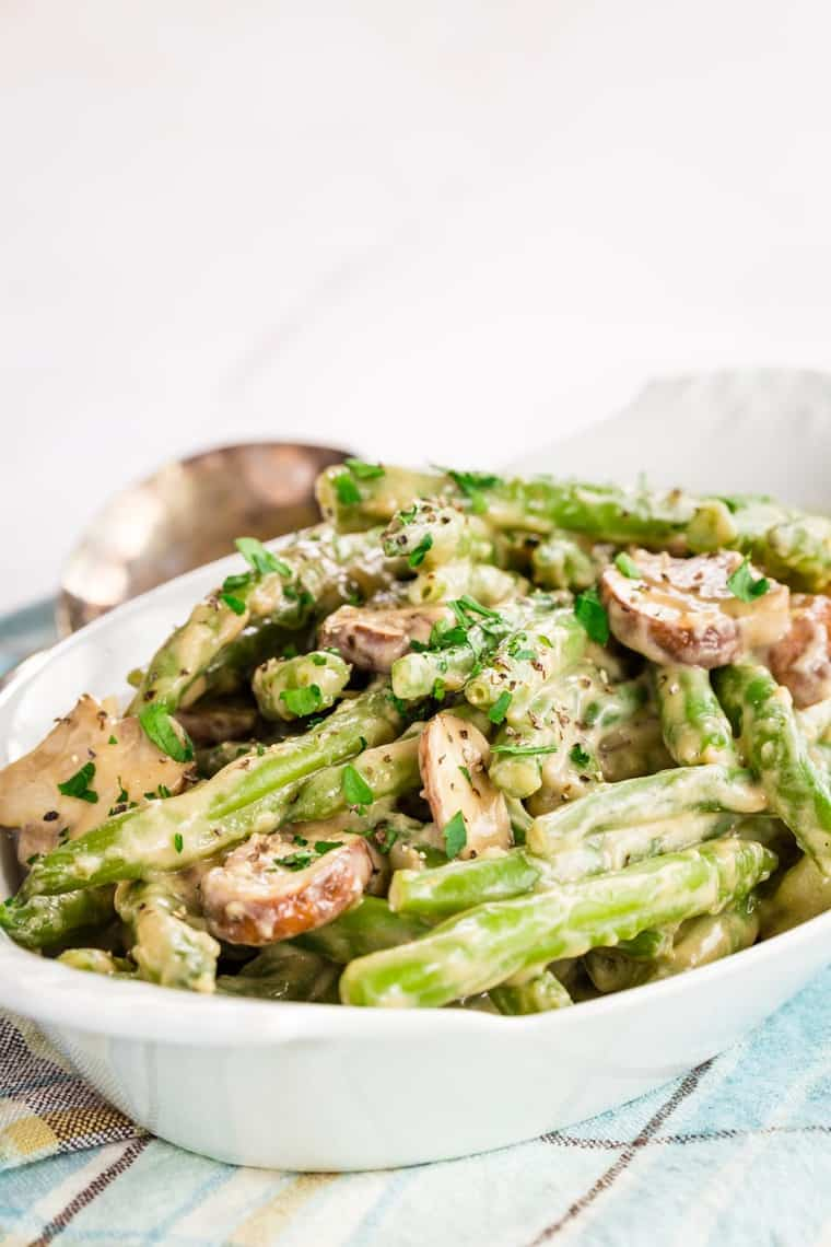 Creamy Green Beans and Mushrooms in a white serving dish