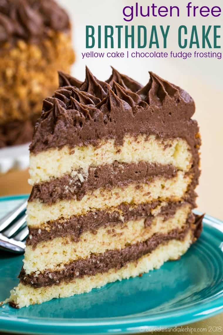 A slice of yellow birthday cake with chocolate frosting