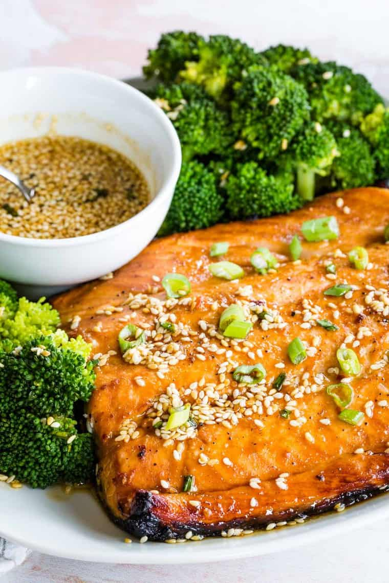 Closeup of Sesame Maple Glazed Salmon with sesame seeds and scallions on top