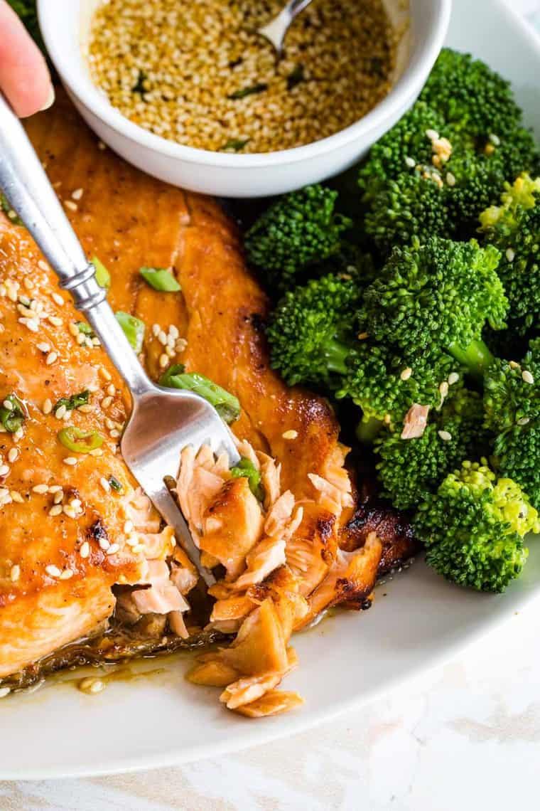 Fork flaking apart broiled maple sesame glazed salmon
