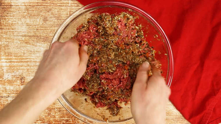 Mixing meatloaf in a bowl