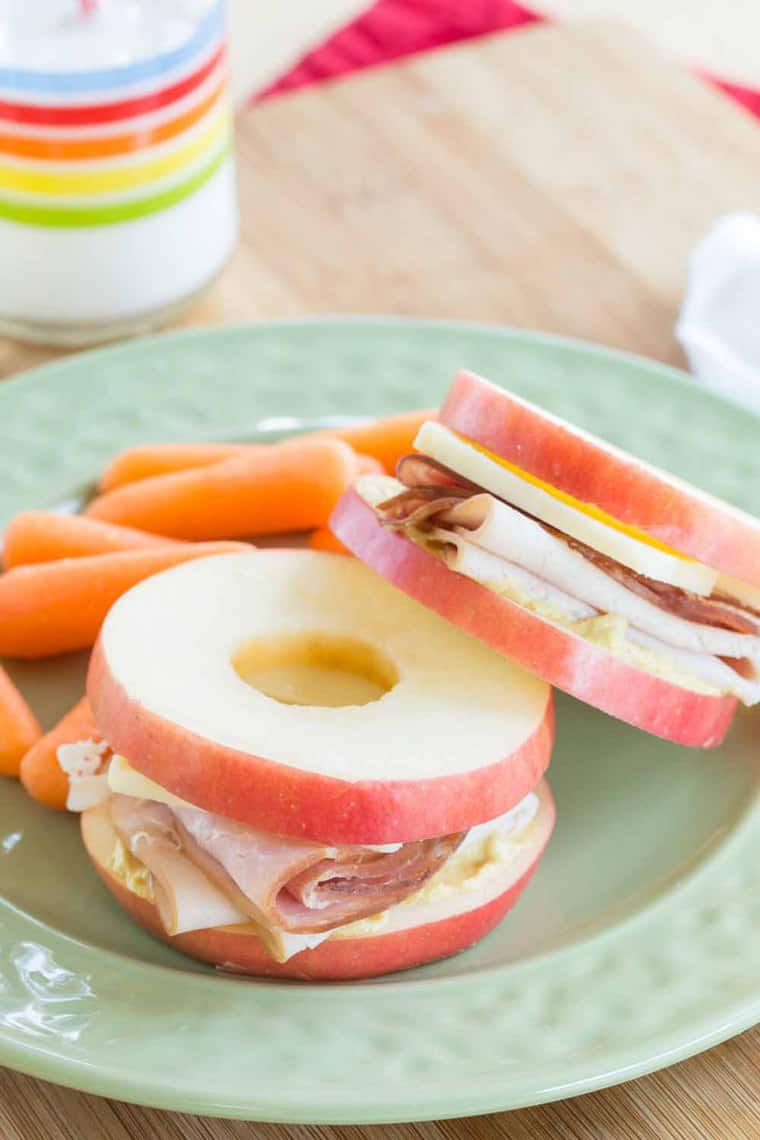Turkey, Ham and Cheese Apple Sandwiches on a plate with baby carrots