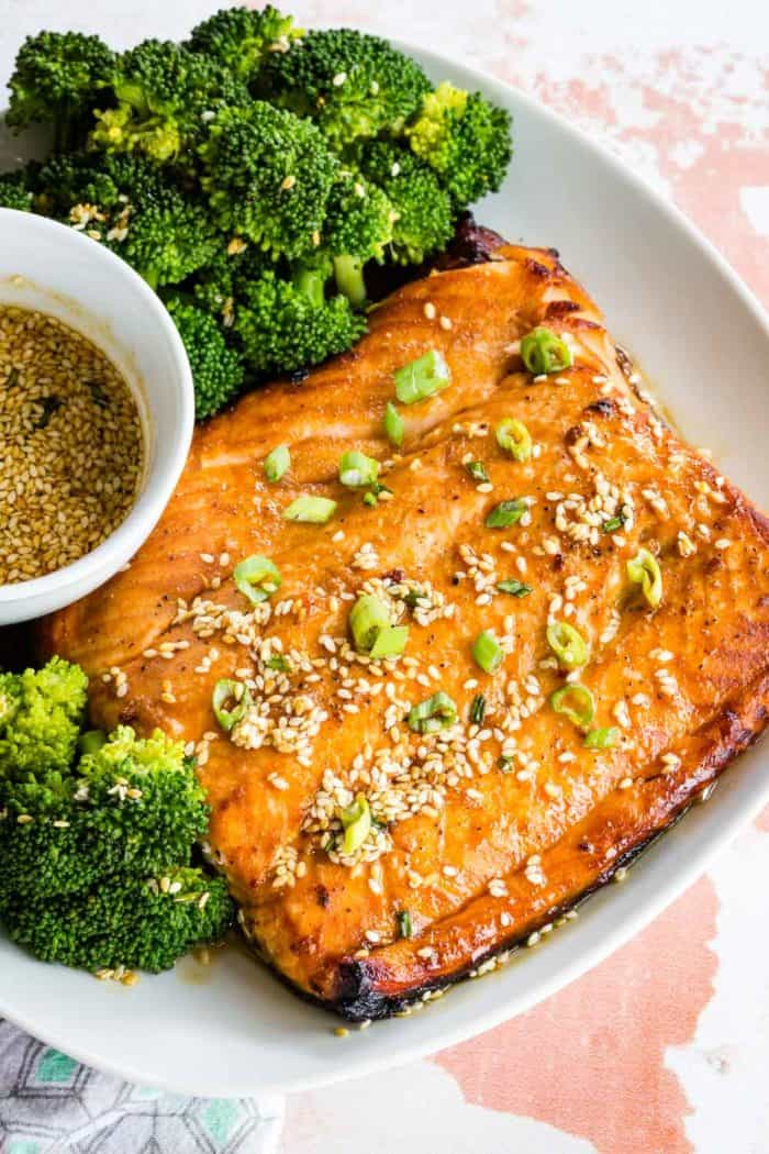 Broiled salmon on a plate with maple sesame glaze