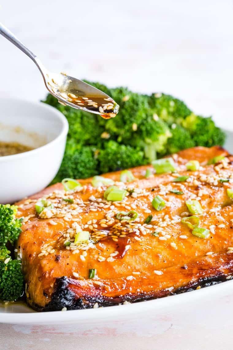 Spooning sauce over Sesame Maple Glazed Salmon