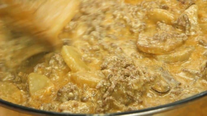 Simmer Cheesy Ground Beef and Potatoes until thickened