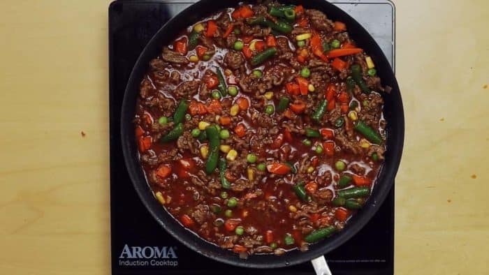 Ground Beef and vegetables simmering with sauce for Shepherd's Pie Filling