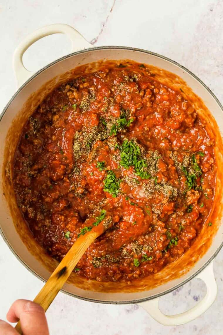 Simmer meat sauce for lasagna