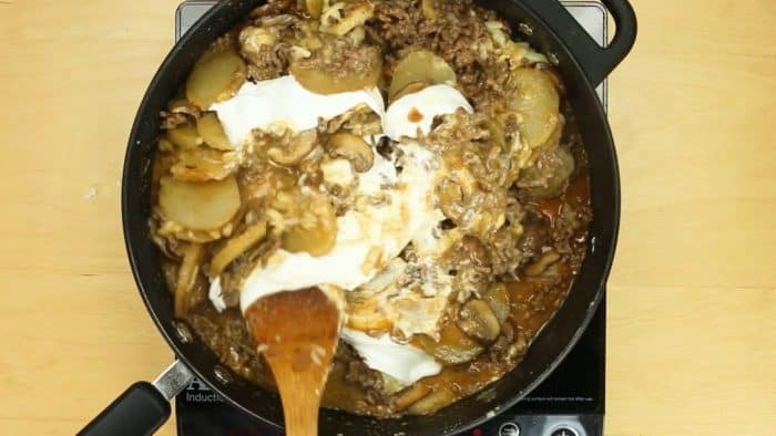 Stir cheddar cheese and Greek yogurt into skillet ground beef and potatoes