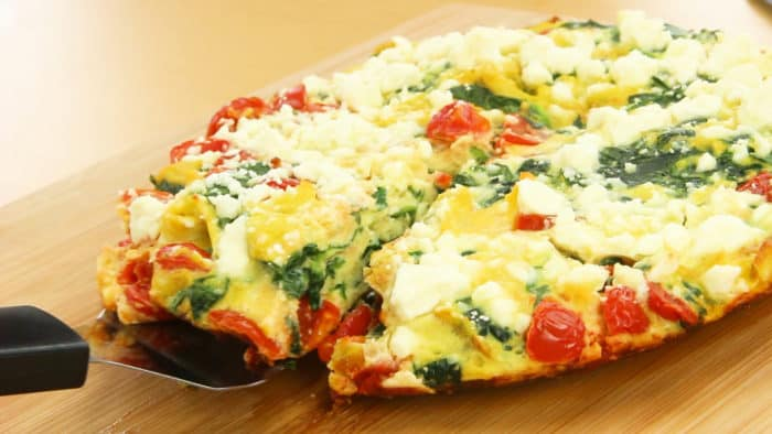 Slice on a cutting board and serve spinach frittata