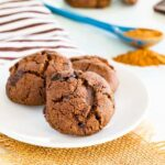 Flourless Spicy Chocolate Cookies with cinnamon, ginger, and cayenne mix in the background