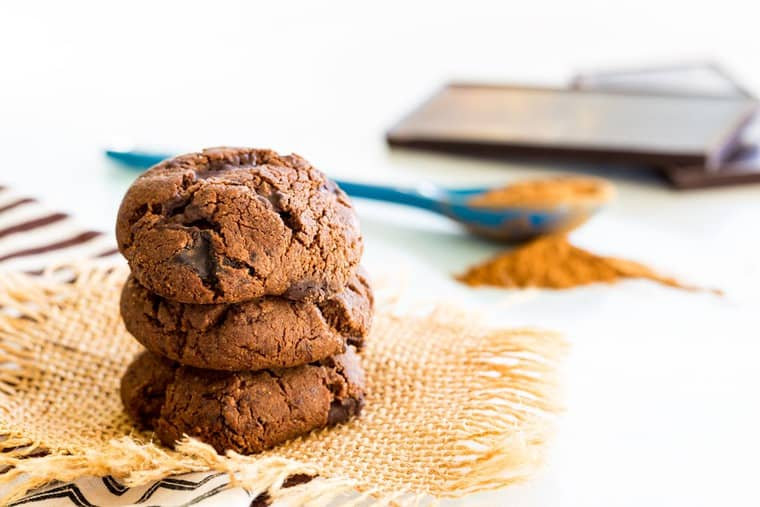 Flourless Spiced Chocolate Cookies with cinnamon, ginger, and cayenne mix in the background