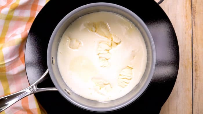 Melting vanilla ice cream in a pot