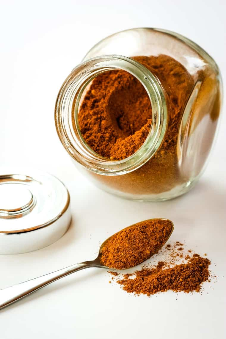 A jar and a spoon of Mexican Chocolate Spice Blend