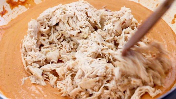 Stir shredded chicken into creamy enchilada sauce