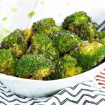 Roasted Broccoli with Soy Sauce and Sesame Seeds in an oval serving dish