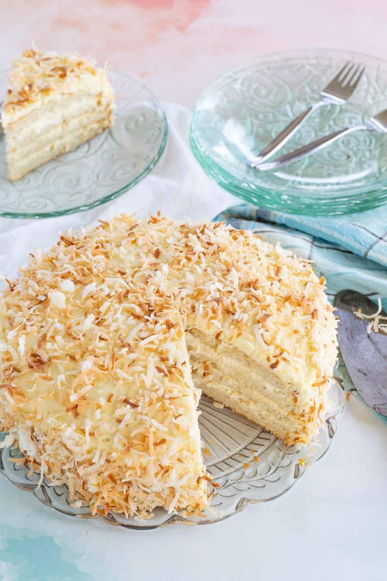 Gluten Free Coconut Cake with a slice removed